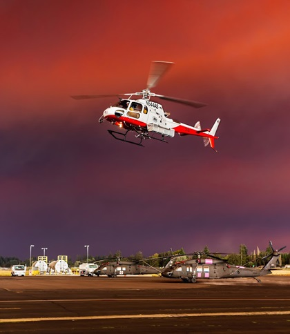Under a smoke-darkened sky, a firefighting helicopter operates at Aurora State Airport in Aurora, Oregon. Photo by Aric Krause, courtesy of Van's Aircraft.