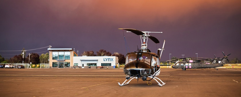 Daylight filters through smoke, illuminating helicopters based at Aurora State Airport in Aurora, Oregon, in September. Photo by Aric Krause, courtesy of Van's Aircraft.