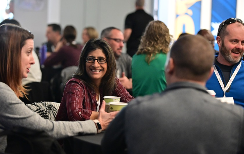Educators socialize during the 2019 AOPA High School Aviation STEM Symposium in Denver. The 2020 event will be held virtually beginning November 17. Photo by David Tulis.