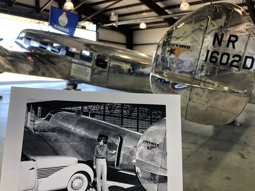 A photo of Amelia Earhart in front of her Lockheed Electra L-10E that she was flying when she disappeared during her circumnavigation attempt is held in front of the sister model L-10E that will be the centerpiece of a new Amelia Earhart Hangar Museum being built in her hometown of Atchison, Kansas. Photo by MeLinda Schnyder.