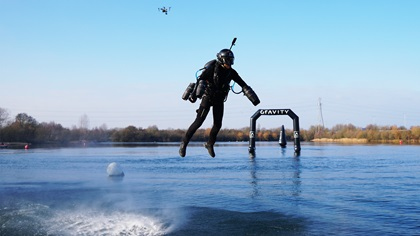 Richard Browning navigates a jet suit racecourse set up over water. Photo courtesy of Gravity Industries.