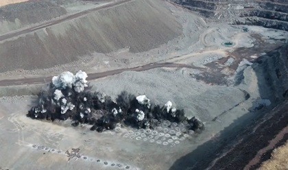 Aerial observers look for abnormalities during a typical mine blast. Photo courtesy of ArcelorMittal USA.