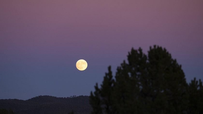 A nearly-full moon rises over the hills surrounding the Village of Ruidoso. Photo by Zach Ryall.