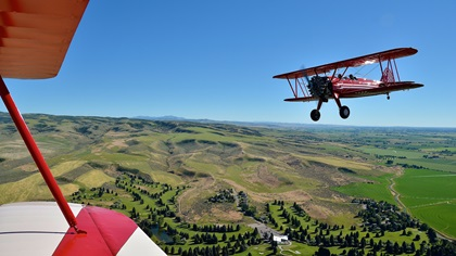 It doesn't get any better than this: A formation flight with a pair of Stearmans, led by AOPA member Bob Hoff over his private airstrip in Idaho Falls, Idaho, sealed the author's interest in formation flying. Photo by Chris Eads.