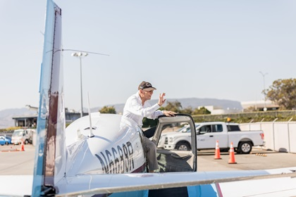 Harry Moyer waves to the dozens of people who came to San Luis County Regional Airport in California to watch his solo flight on his 100th birthday. Photo by SLO Town Studios/Welcome Home Military Heroes.