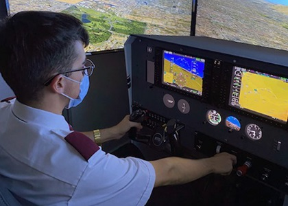 A student tries out a reconfigurable training device from Frasca International during a road show introducing the technology at flight training operation locations. Photo courtesy of Frasca International.