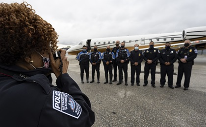 Emergency services personnel celebrate the final stop of the America's Operation Thank You general aviation flight relay. Photo by David Tulis.