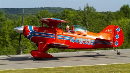 Marc Nathanson, pictured here at the Green Mountain Aerobatic Contest in July 2015, has flown his Pitts S-1T to aerobatic contests for years. This particular Pitts model is highly regarded for its power-to-weight ratio, but not so much for its luggage accommodations. Photo by Jim Moore.