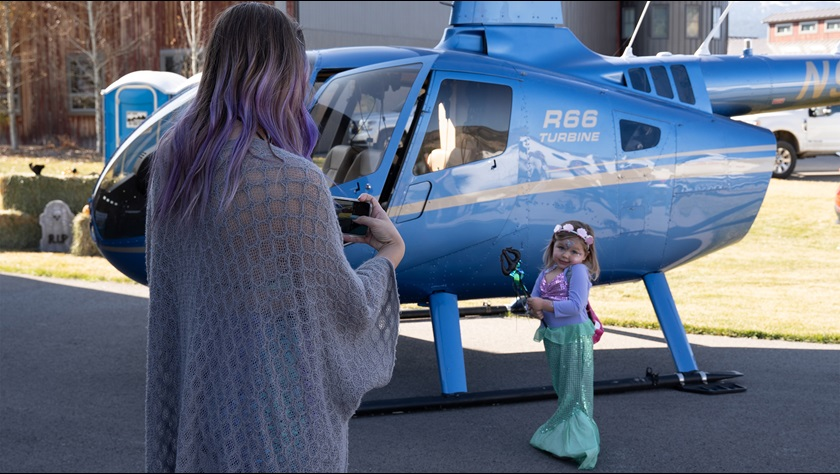 Airpark and community residents attended a Halloween-themed event and ceremony for the airport to present the donation check. This little mermaid might just trade her tail for some helicopter lessons. Photo by Jenna Bradford.