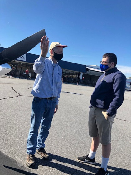 STEM Flights Pilot Mentor Bill Kahn demonstrates how to check the prop during preflight inspection. His passenger, Gabe Turner, is currently taking the AOPA High School STEM Curriculum at Greenville Technical Charter High School in Greenville, South Carolina. Photo courtesy of STEM Flights.