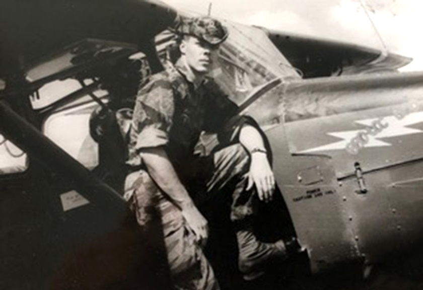 A 22-year-old Ron Allen poses during the Vietnam War on the strut of a Cessna 0-1E Bird Dog which was named the 'Bao Loc Bad Guy.' Photo courtesy of Ron Allen.