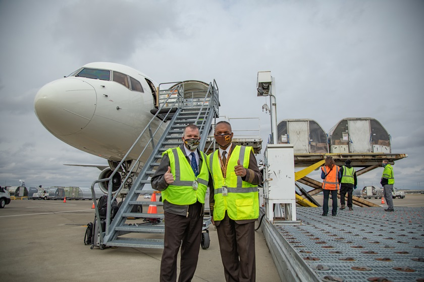 UPS pilots Neal Newell (left) and Houston Mills pause for a photo as the vaccine is unloaded in Louisville, Kentucky, on December 13. Photo courtesy of UPS Inc.