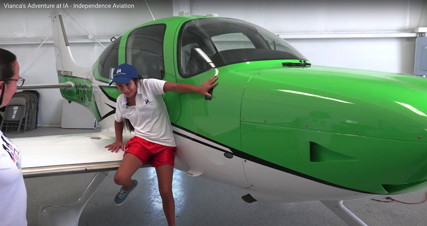 Bernice Geels looks on as granddaughter Vianca Marez, 12, who was born blind, jumps from the wing of a Cirrus single-engine aircraft after handling the flight controls of a Cirrus SR20 with backup from Independence Aviation LLC owner and CFI Bob Stedman in Denver. Image courtesy of Angel Andres Rosado, Independence Aviation LLC.