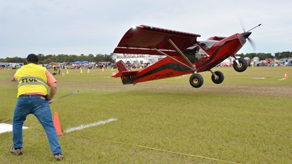 Jack Klein of Little Rock, Arkansas, marks the takeoff spot of a STOL aircraft that got airborne in less than 75 feet. The demonstration of extreme aircraft performance capabilities thrilled hundreds of spectators throughout the two-day event. Photo by Chris Eads.