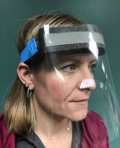 A face shield prototype is demonstrated after Michigan Seaplane owner Cran Jones formed a plan to manufacture and deliver much-needed clear face shields to front-line medical professionals. Photo courtesy of Cran Jones.