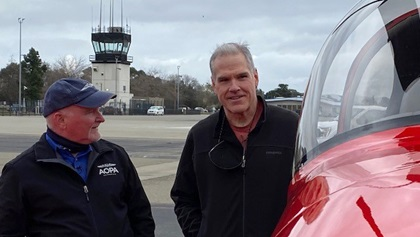AOPA President Mark Baker surprises Aaron Benedetti with the AOPA Sweepstakes RV-10. Photo by Chris Rose.