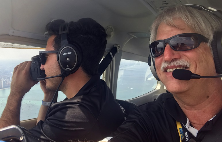 The author and AOPA Social Media Marketer Kevin Cortes fly near the Chicago skyline before landing at Burke Lakefront Airport in Cleveland, Ohio, and checking in with the AOPA app's Pilot Passport feature. Photo by David Tulis.