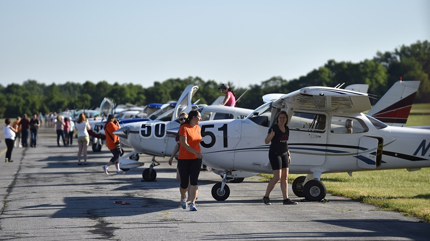 Volunteers and competitors prepare to start a four-day, 14-state cross country journey from Frederick, Maryland, to Santa Fe, New Mexico, as part of the 2017 Air Race Classic. For 2021, the organization has announced the Air Race Derby, a one-day VFR event open to all types of aircraft. Photo by David Tulis.