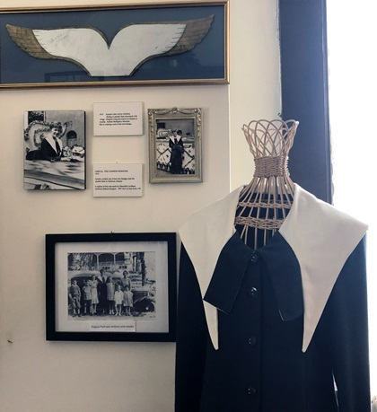 Earhart wore a dress of her own design on her final visit to Atchison, Kansas (replica dress shown with photos from the hometown parade where she wore it). Photo by MeLinda Schnyder.