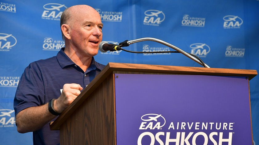 Piper CEO Simon Caldecott, seen here reacting to strong aircraft sales numbers at EAA AirVenture in Oshkosh, Wisconsin, in July 2018, will retire on April 2 after a 47-year career in the aviation industry. Photo by David Tulis.