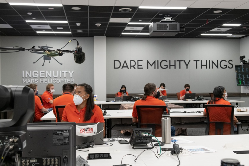 """Members of NASA's """"Ingenuity"""" helicopter team in the Space Flight Operations Facility at NASA's Jet Propulsion Laboratory prepare to receive the data downlink showing whether the helicopter completed its first flight on April 19, 2021. Photo courtesy of NASA/JPL-Caltech."""