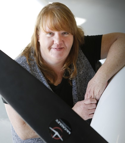 AOPA Copy Editor Kristy O'Malley, who spent her career in journalism, died May 21 at age 52. Photo by Chris Rose.