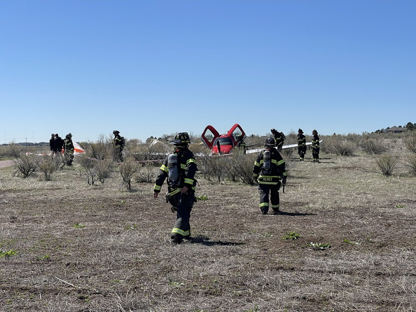 A Cirrus SR22 with two people aboard touched down under its airframe parachute after colliding with a Fairchild Swearingen Metroliner hauling cargo as both aircraft approached parallel runways at Centennial Airport in Denver on May 12. The badly damaged Metroliner landed without incident or injuries. Photo courtesy of South Metro Fire Rescue.
