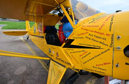 The front seat of a Piper J-3 Cub contains backpacking gear, a tent, and other necessities for Ben Templeton's 48-state flight. Photo by David Tulis.