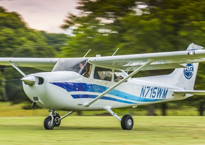 A Flyt Aviation pilot waves after landing in a Cessna 172 Skyhawk during Vintage Day at Peach State Aerodrome in Williamson, Georgia. Photo courtesy of Leigh Hubner.
