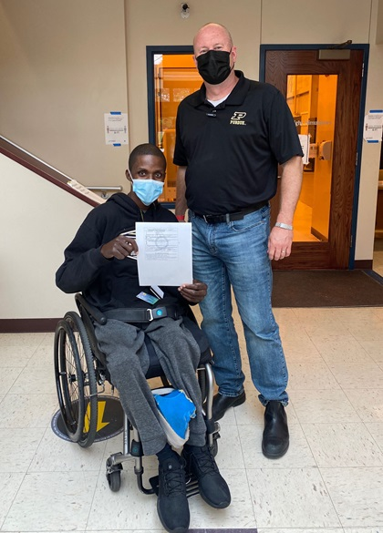 U.S. Army veteran T'angelo Magee, pictured with designated pilot examiner Brian Dillman, served seven tours before becoming paralyzed in an accident. He earned his sport private certificate after training with Able Flight. Photo courtesy of Able Flight.