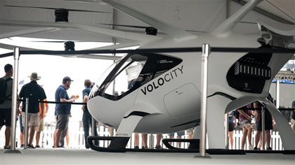 Visitors to Volocopter's exhibit at EAA AirVenture were given a chance to try a VoloCity model on for size. Photo courtesy of Volocopter.