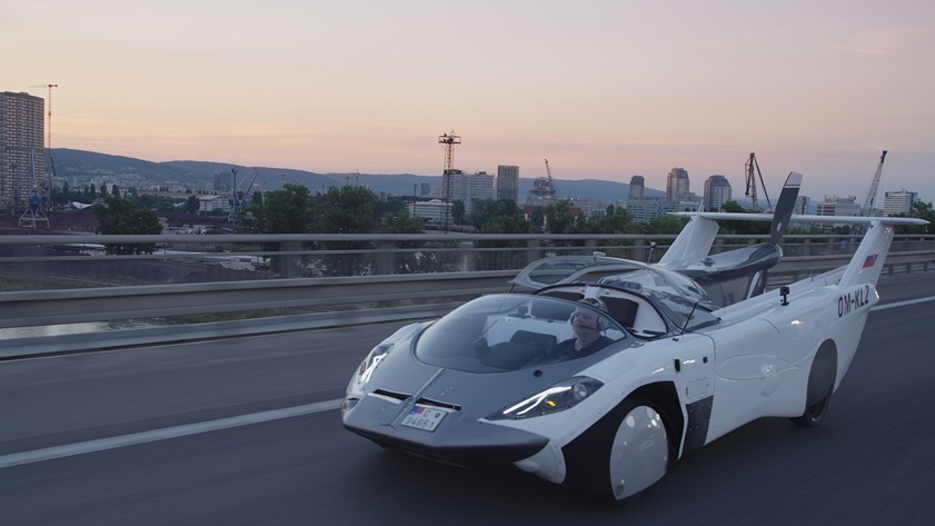 Wings and tail tucked, the AirCar takes the road as a convertible in more senses than one: In this photo, the canopy is retracted. Photo courtesy of Klein Vision.