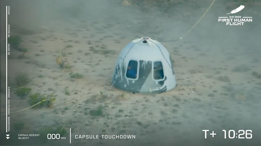 The New Shepherd capsule touched down softly under parachutes, with a short blast of rocket power to soften the landing. Image courtesy of Blue Origin via YouTube.