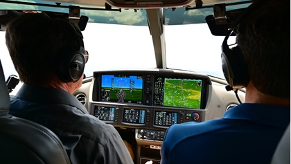 Tom Haines, AOPA senior vice president of media, communications, and outreach, pilots a Cirrus SF50 Vision Jet. Photo by David Tulis.