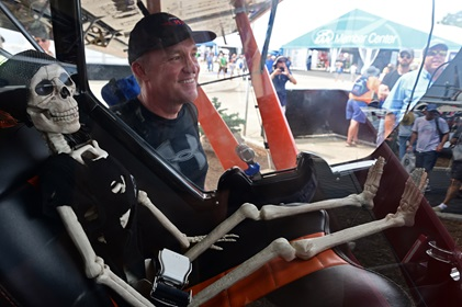 'Scrappy,' the eponymous skeleton sitting in the pilot seat of Mike Patey's latest STOL aircraft, draws the attention of Mark Gregson during EAA AirVenture July 28. Photo by David Tulis.