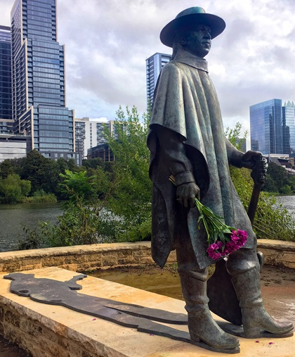 This eight-foot-tall bronze statue of Austin resident Stevie Ray Vaughan is popular with tourists and visiting musicians, including some who leave flowers behind. The city of Austin erected the statue near the shore of Lady Bird Lake in 1994 to honor the blues guitar legend who died in a helicopter accident in 1990. Photo by MeLinda Schnyder.