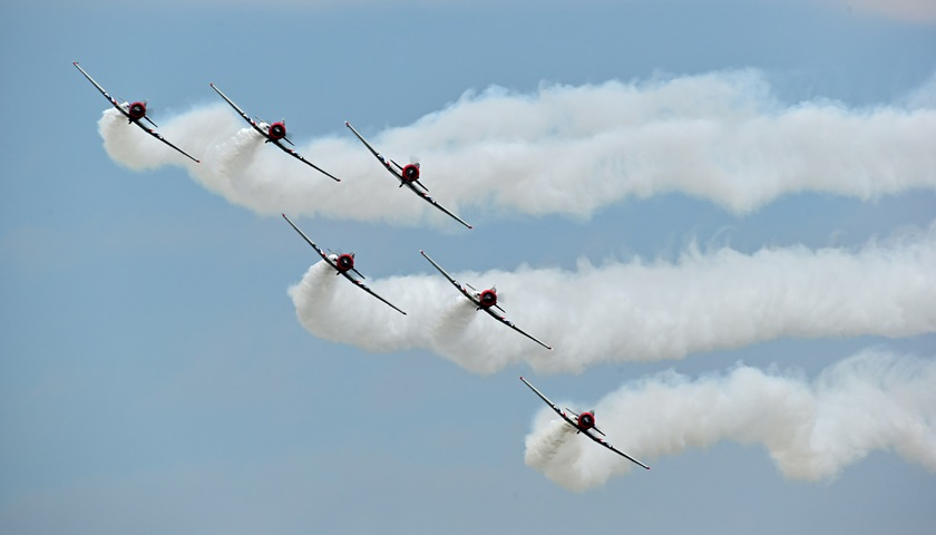 The Geico Skytypers Air Show Team performs during EAA AirVenture. Photo by David Tulis.