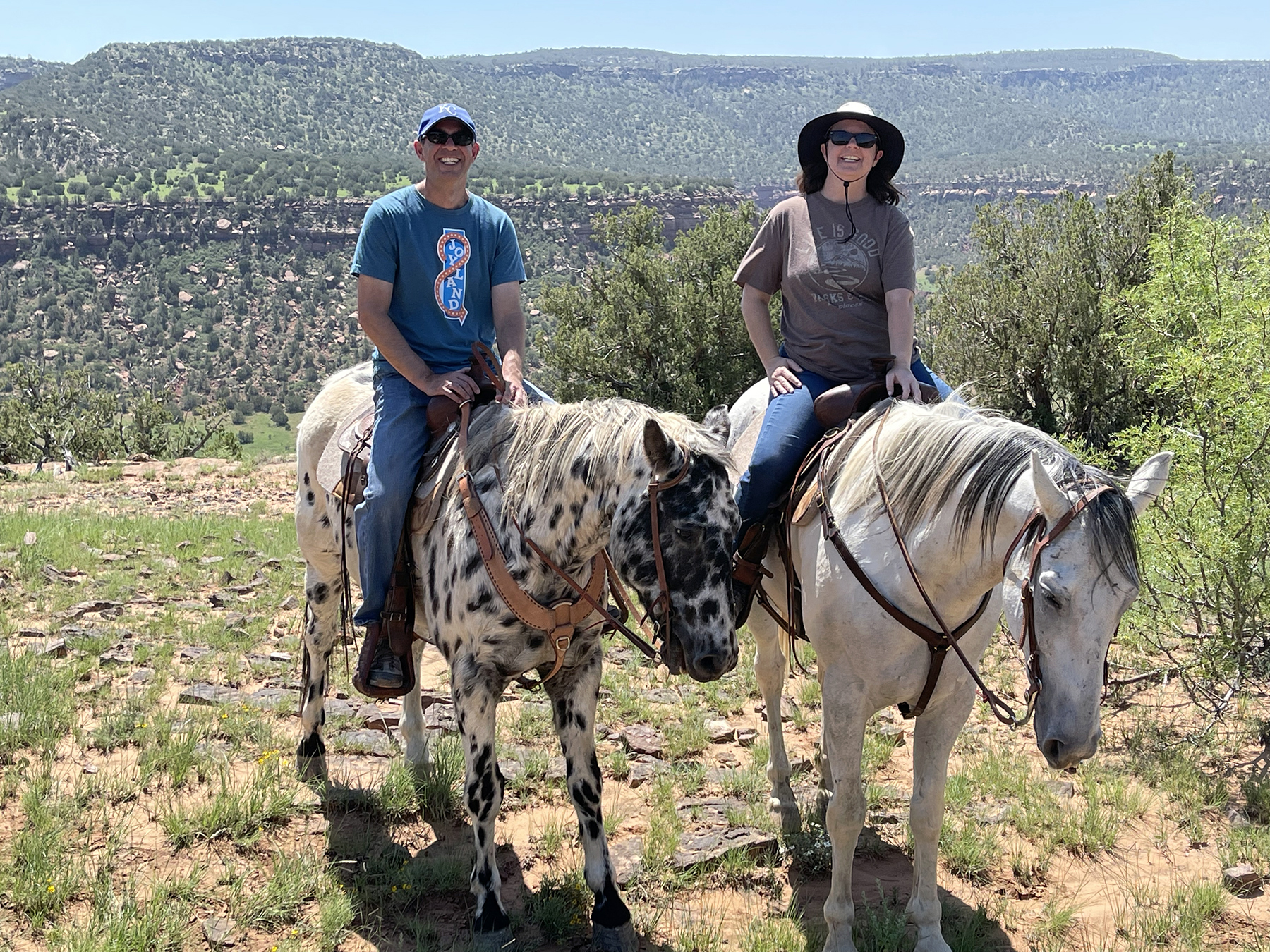 The author and her husband exploring some of the 14,000 acres at Canyon Madness Ranch in northeastern New Mexico. The ranch has a full equestrian program and staff can customize an experience to guests' experience level. Photo by MeLinda Schnyder.