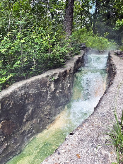Hot Springs National Park turns 100 this year. It was created to protect and preserve the 47 thermal springs found here. This flow of hot spring water running down from Hot Spring Mountain is found on the Tufa Terrace Trail. Photo by MeLinda Schnyder.